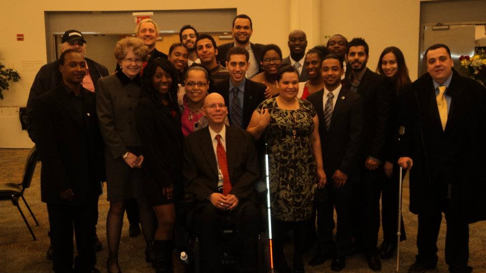 Photo of CUNY students, Student Affairs staff, and Logue taken immediately after the November 28, 2011 Board of Trustees meeting
