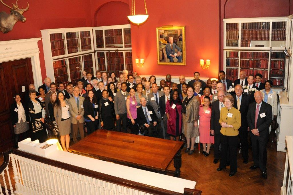 Photograph of people at May 3, 2013 Harvard Club dinner thanking all of the faculty, staff, and students who had worked with the central office on Pathways